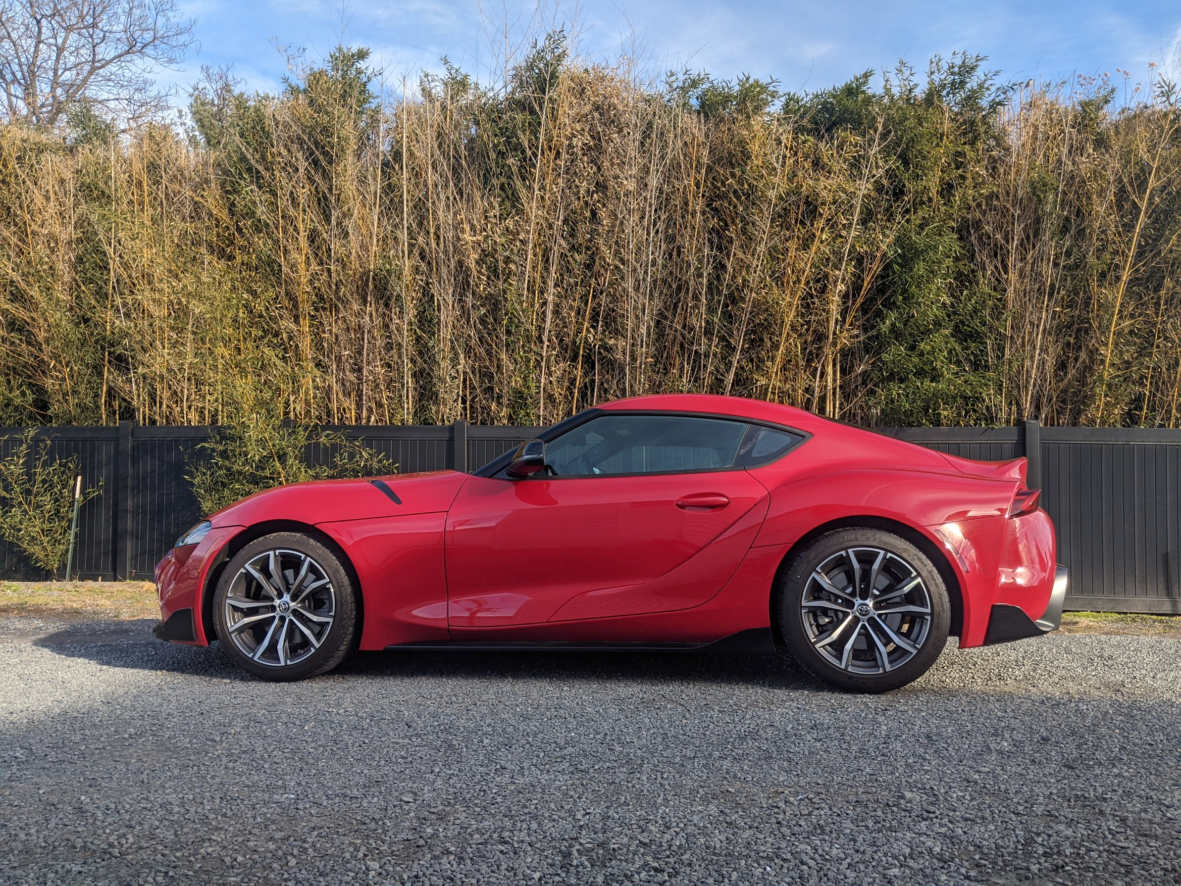 Red 2021 Toyota GR Supra 2.0 in front of bamboo