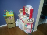Our role play area. The drawers contain play food and tea sets.