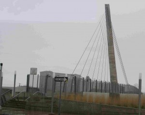 'Drunken' suspension tower of Bagley Pedestrian Bridge over I-75 seen from Detroit's Mexicantown.