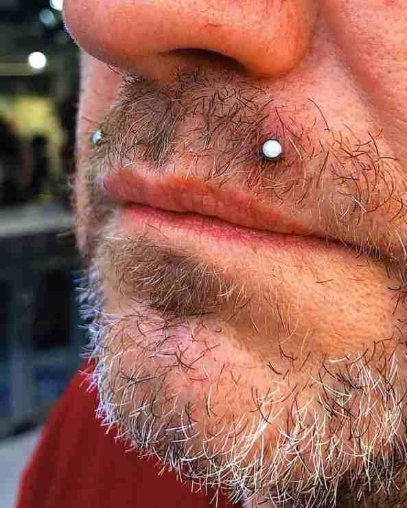 men angel bite piercing