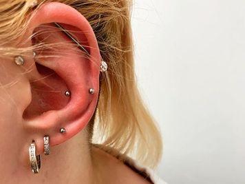 snug and forward helix piercing