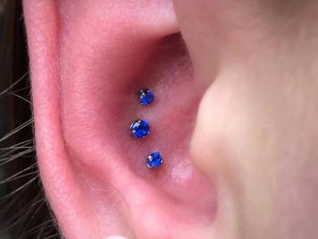 triple conch piercing