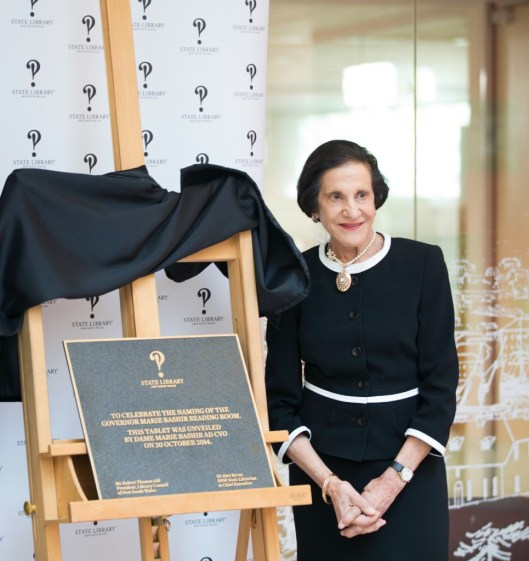 Dame Marie Bashir unveils a plaque at the Reading Room named in her honour at the State Library of NSW.