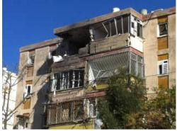 apartment_building_in_Kiryat_Malachi_takes_a_direct_rocket_hit_resulting_in_three_dead_and_six_wounded