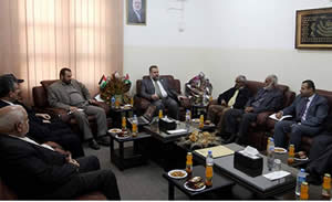 Fathi Hamad minister of the interior in the Hamas administration meets with Osama al-Muzeini minister of education