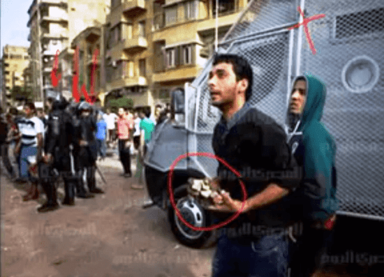 Egyptian Security watch Muslim youths throw rocks and do nothing