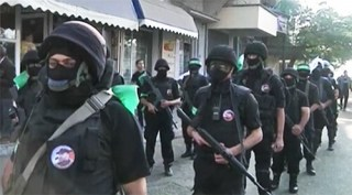 Hamas civil servants in the streets of Gaza. Image source YouTube video