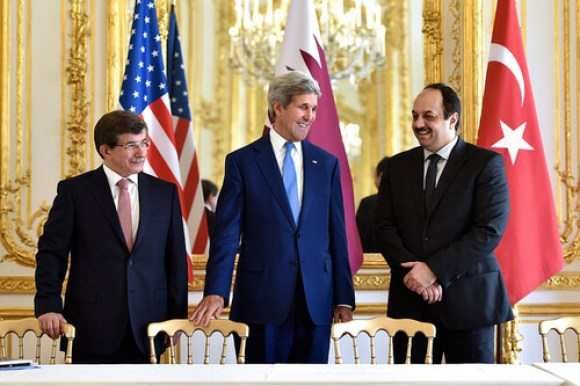 U.S. Secretary of State John Kerry shares a laugh with Turkish Foreign Minister Ahmet Davutoglu and Qatari Foreign Minister Khalid Al Attiyah