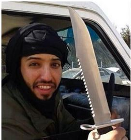 Al Anzi brandishing an ISIS butcher knife