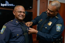 Capt Hosein receives his Captains Badge from Chief Gross