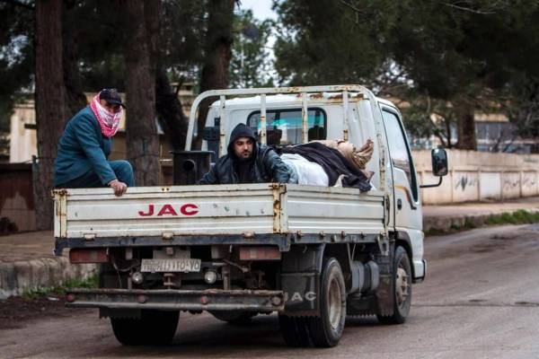 Christians on a pick-up truck with their belongings as they flee the town of Tel Tamer