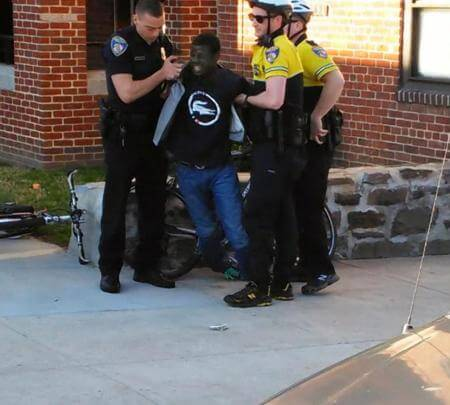freddie-gray-while-cell-phone-on-top-of-knife
