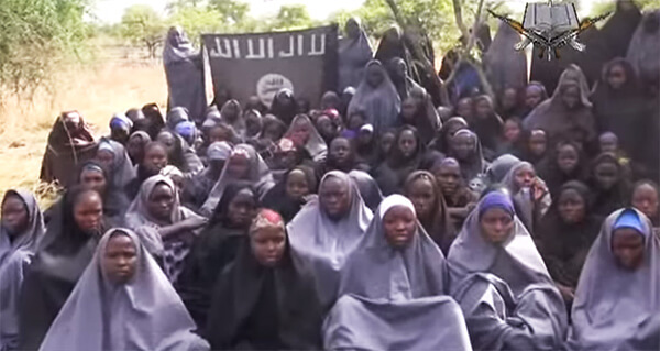 Some of the hundreds of Christian Nigerian schoolgirls who were abducted last year by Boko Haram. (Image source: Boko Haram video)