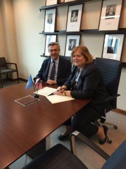 Anne Richard, Asst. Sec. of State for PRM signing cooperation agreement with new UNHCR Filippo Grandi.