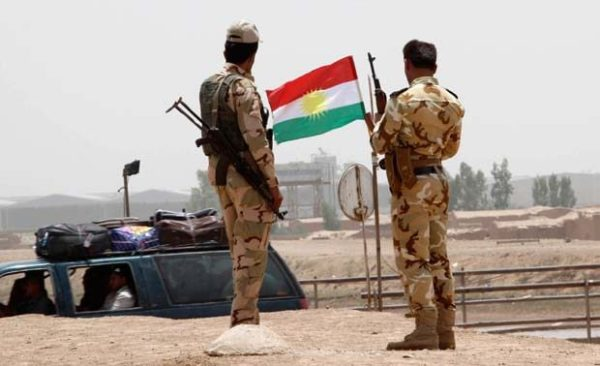 Members of the Kurdish security forces stand at a checkpoint during an intensive security deployment on the outskirts of Kirkuk June 11, 2014. Reuters Photo