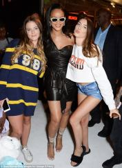 Rihanna visits Savage x Fenty pop up shop in London on June 15, 2018 posing with fans