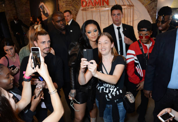 Rihanna visits Savage x Fenty pop up shop in London on June 15, 2018 with fans