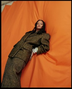 Rihanna covers Allure's October 2018 Issue in a suit on orange background