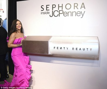 Rihanna at Fenty Beauty's anniversary party on September 14, 2018 posing with big Diamond Milk replica