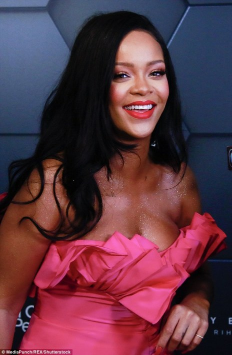 Rihanna at Fenty Beauty's anniversary party on September 14, 2018 with a big smile on her face