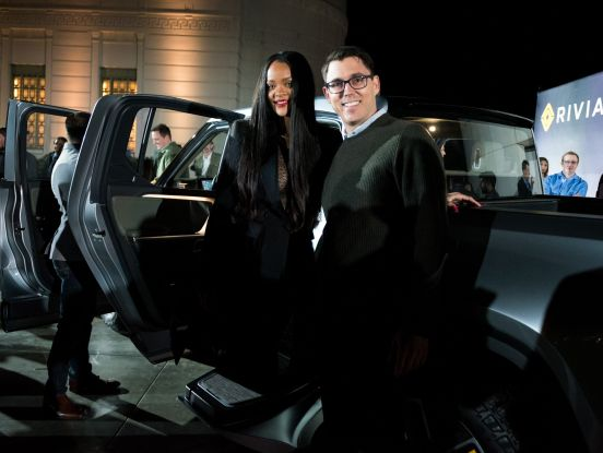 Rihanna attends Rivian event in Los Angeles posing with CEO of Rivian on November 26, 2018