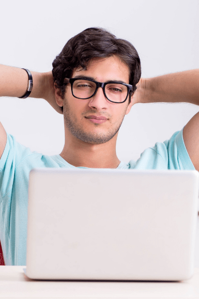 man looks at laptop screen