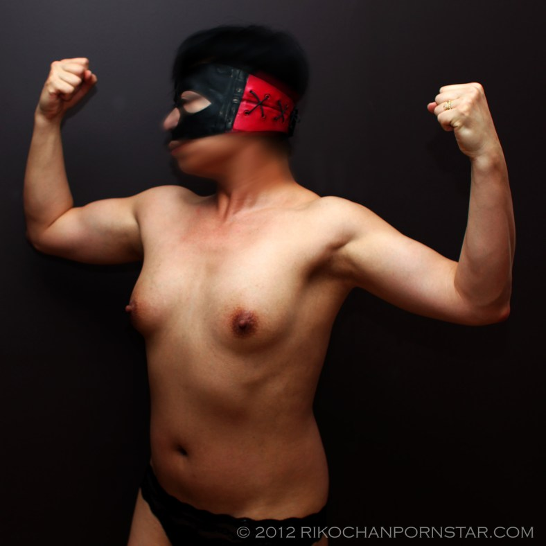 topless flexing picture with my Klawtex latex mask