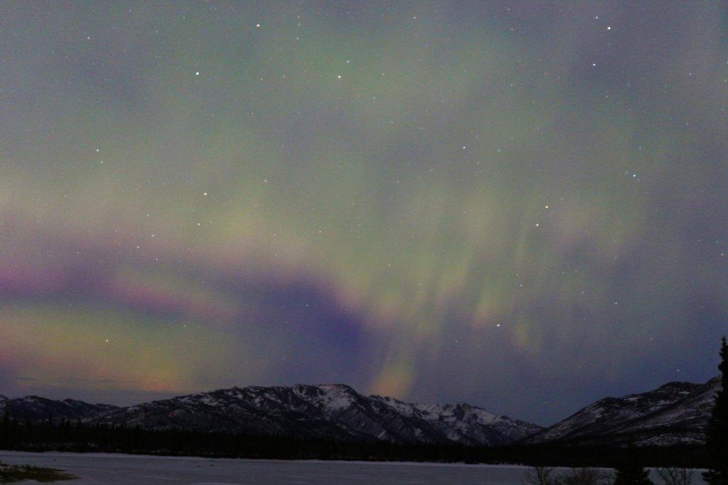 The aurora borealis dance over Otto Lake in Healy