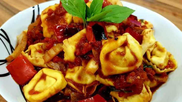 Bolognese Tortellini with Roasted Red Pepper Sauce