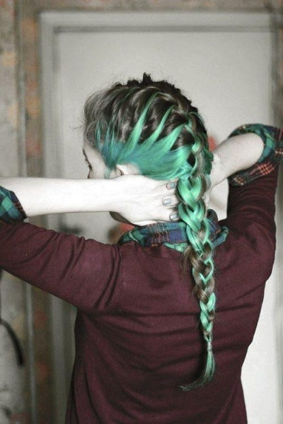 Fishtail braid ponytail hairstyle with green highlights