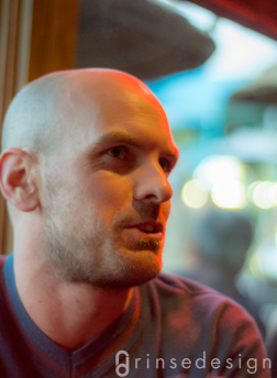 Sometimes you just luck out. The one random shot I took of Paul chatting at the bar turned out to be a fascinating portrait that captured his purposeful nature