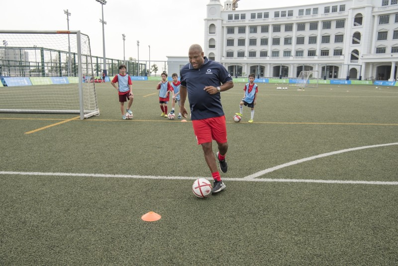 Former Liverpool Football Club star John Barnes participates in the Standard Chartered Liverpool Football Clinic at the Harrow International School in Hong Kong, China, on Saturday, April 16, 2016. Photographer: David Paul Morris/i3