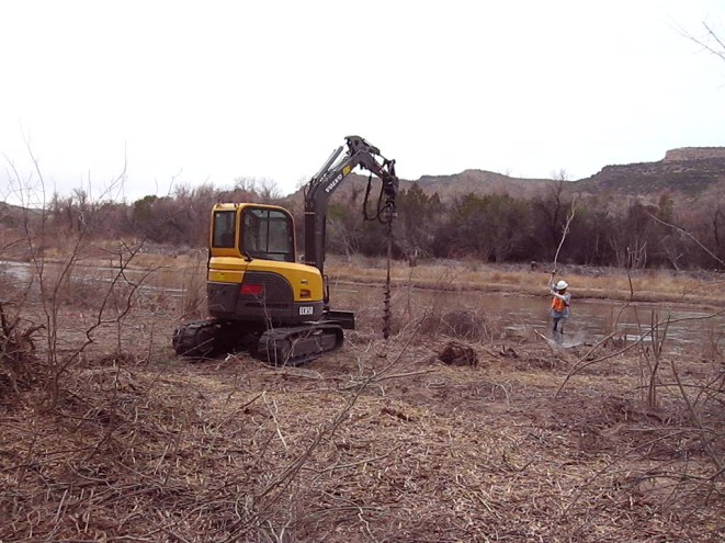 21. After the forestry work was completed - the invasive trees removed and masticated - we came back with an auger and drilled holes 8 feet deep to the water table. This allowed us to plant the cottonwood and willow poles deep enough so they would stay wet and eventually root.