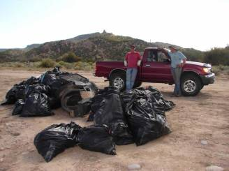 10. Alan Hamilton Executive Director of Rio Grande Return and Rich Schrader Executive Director of River Source getting ready to take some of the garbage collected by the volunteers to the dump.