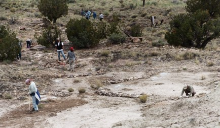 Here you can really feel the sense of community in all the activity in one little drainage. Everyone is engaged, either carrying rocks, building dam, or seeding.