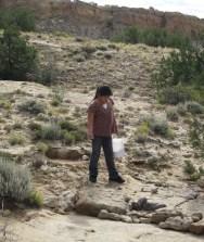 Olivia planting native seeds