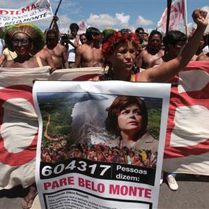 Protester holding a sign saying Stop Belo Monte, Brazil News