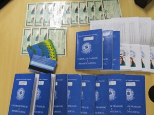 Identification and work card documents seized in the operation, Brazil News