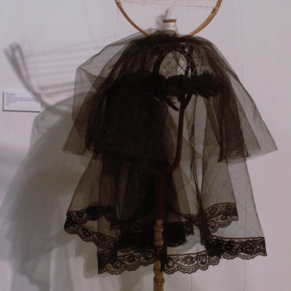 Antenna Veil- tulle from child's costume, woven wire basket, selvage, bamboo handle, kite string, wooden spool, 18x24""