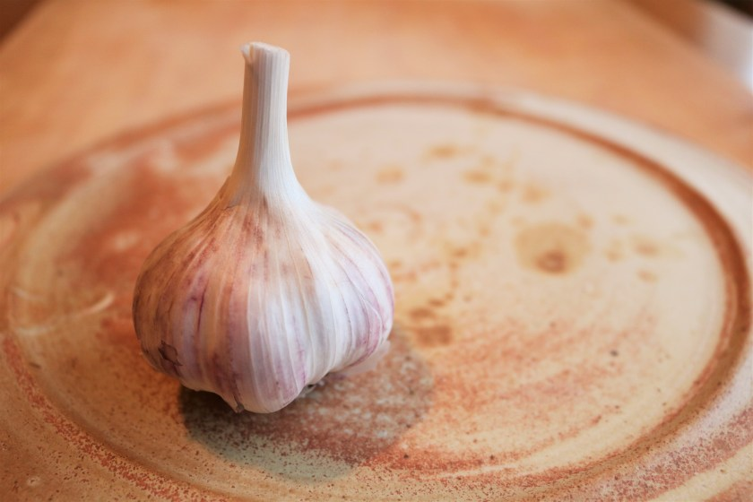For our blog posts archives, we are showing a photo of a garlic clove on a ceramic plate