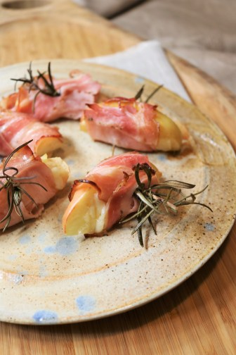 Apples with manchego and pancetta on rosemary sprigs.