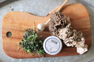 Microgreens, truffle salt, garlic, and Maitake mushrooms