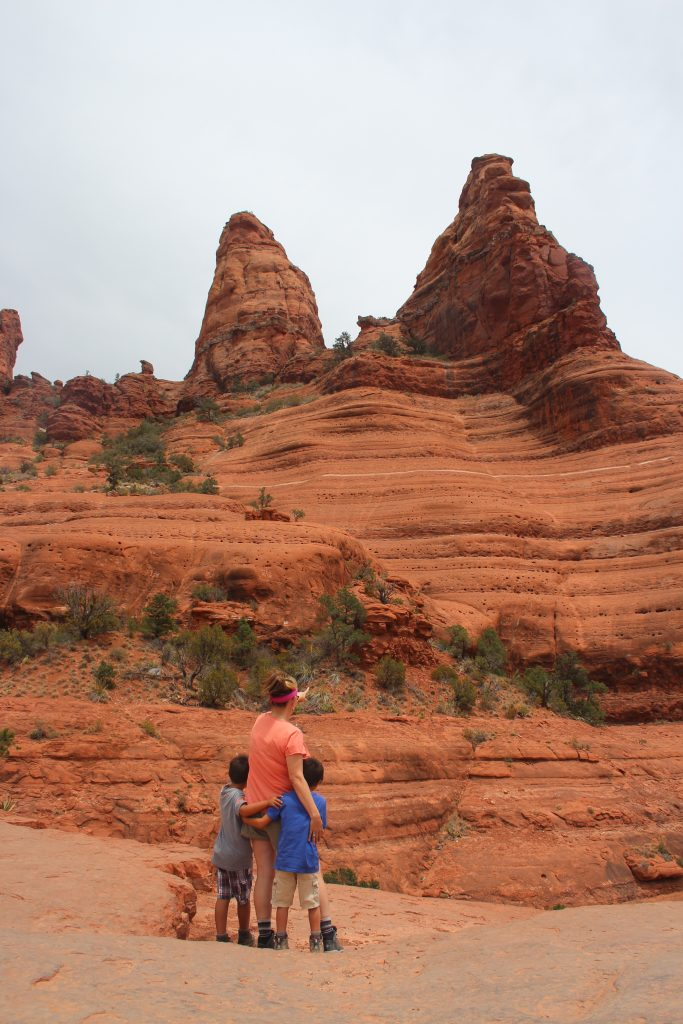 Best Places to stop on a Southwest Road Trip|woman and two boys looking at red rocks in Sedona