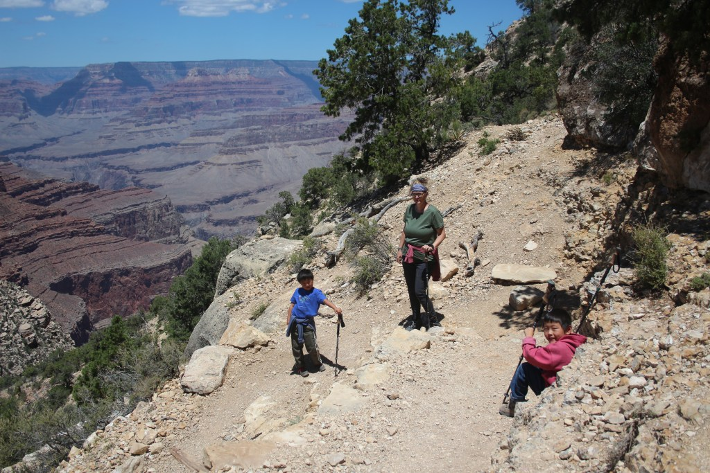 Best Places to stop on a Southwest Road Trip\Woman and two boys hiking