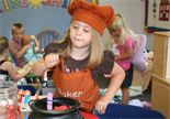 Preschooler playing as a chef