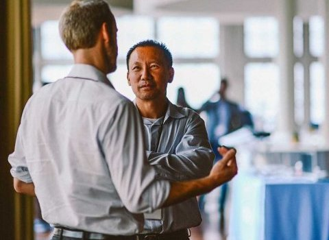 two-men-talking-coworkers