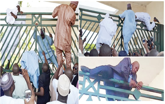 Members-of-House-of-Representatives-climbing-over-the-gate-to-gain-entrance-into-the-National-Assembly-complex-yesterday