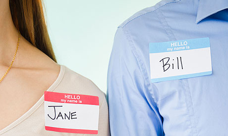 Close up of man and woman standing with name tags