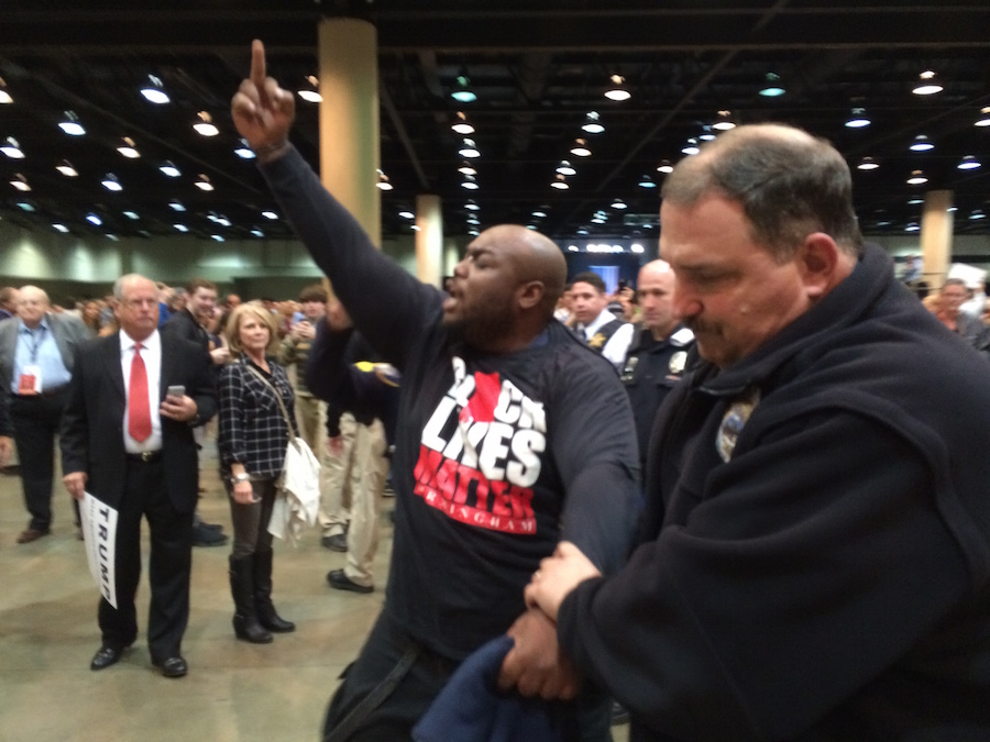 A Black Lives Matter supporter, later identified as Mercution Southall was removed from the Trump rally. Photo Credit: Jordan Cissell/ Rise News.