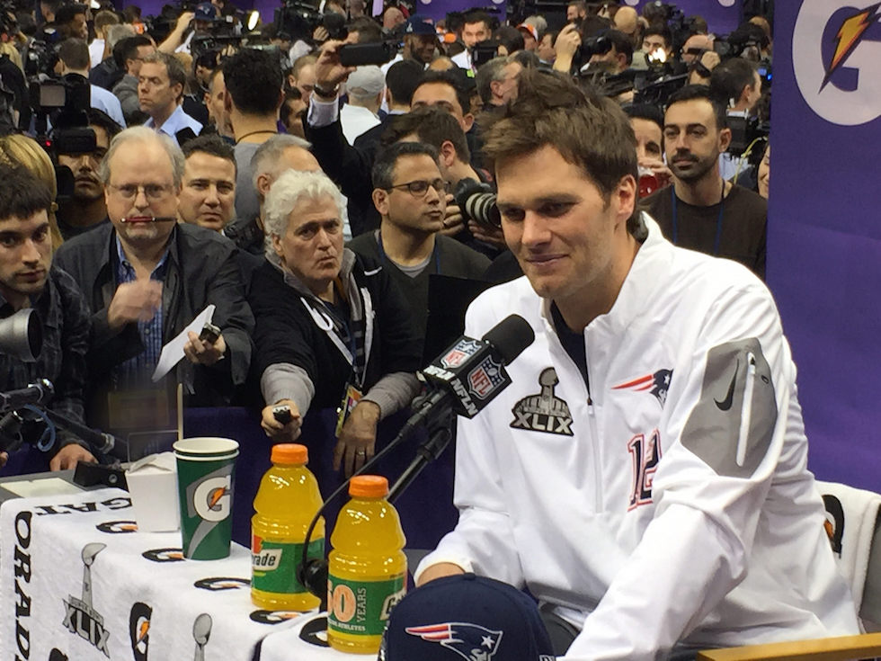 Tom Brady hopes to be at another one of these pre Super Bowl press scrums in a few weeks. Photo Credit: WEBN-TV/Flickr (CC By 2.0)